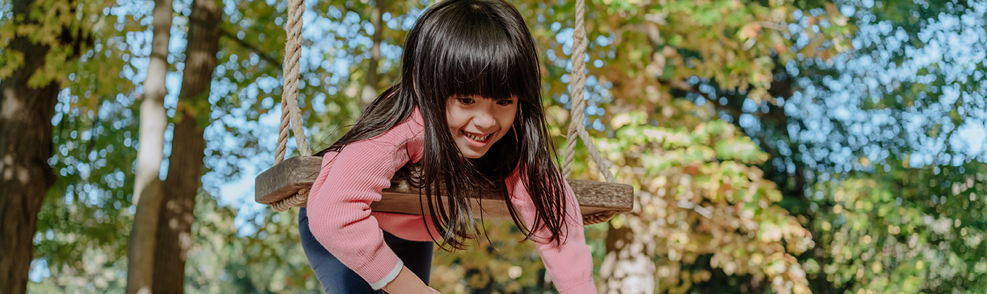 Autistic girl on a swing