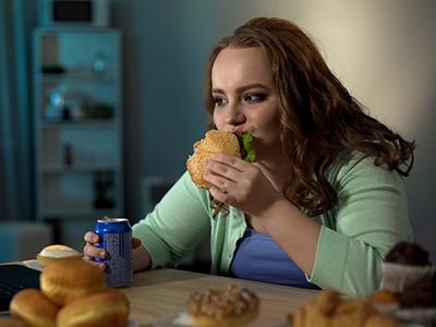 teen eating a burger
